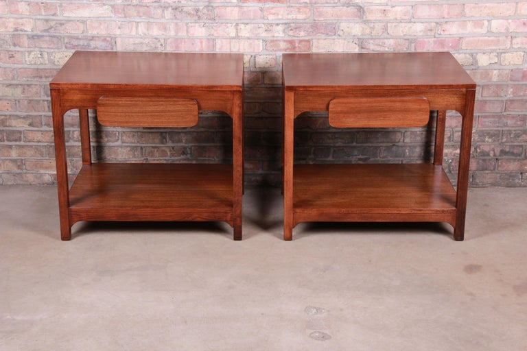 An exceptional pair of Mid-Century Modern elmwood nightstands or side tables