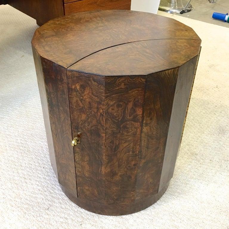 Olive burl sixteen sided columnar pedestal drum cabinet with secret door that opens with original brass