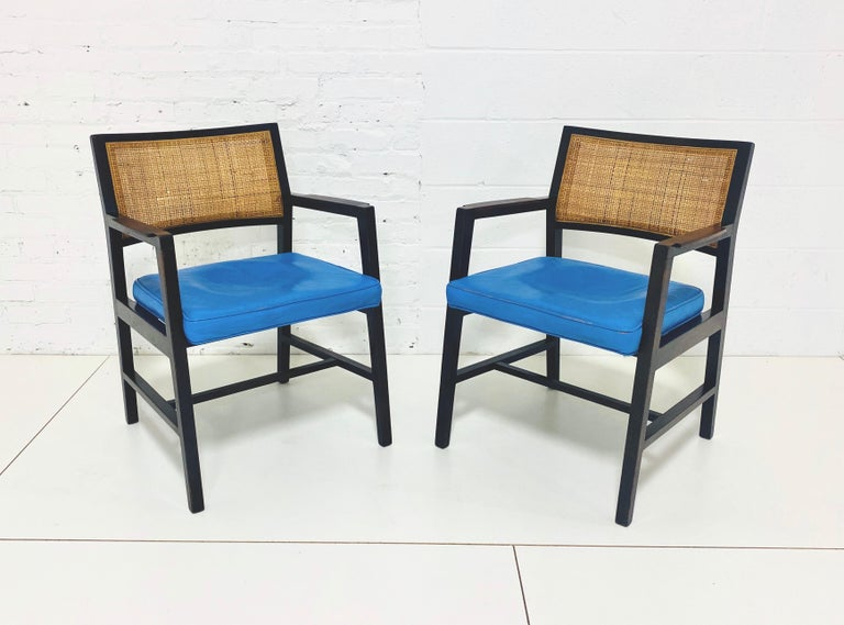 Pair of armchairs in original blue leather with rosewood arms cane backs.