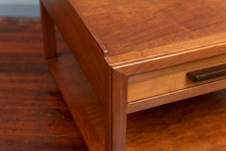 Edward Wormley for Dunbar large end table. Having a single drawer and gallery edge top on brass casters in mahogany, labeled.
