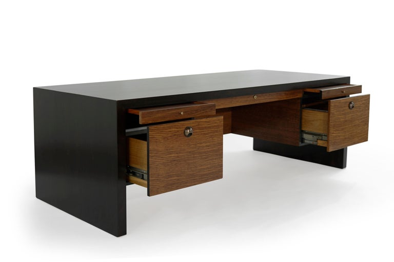 An exceptional and rarely seen executive desk and chair set designed by renowned Mid-Century Modern furniture designer Edward Wormley for Dunbar, circa 1950s.  Features stunning rosewood case stained in dark and sleek midcentury design. It offers