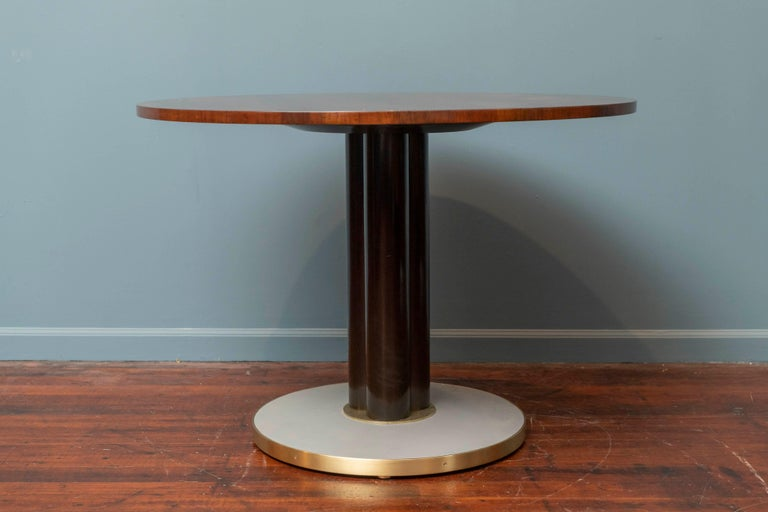 Edward Wormley design for Dunbar game or center table, a stunning rosewood top on an ebonized column-form pedestal supported by a weighted brass and light grey leather wrapped base.