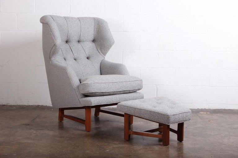 A beautifully restored Janus wing chair and ottoman designed by Edward Wormley for Dunbar.