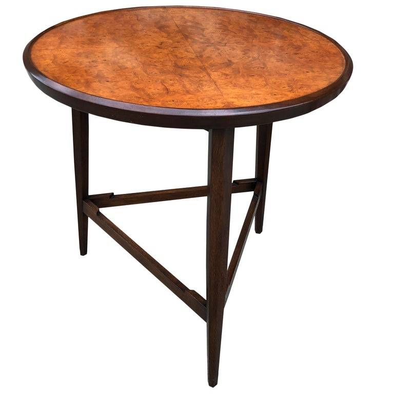 From the 1957 Janus line, this elegant side or snack table has a burl Carpathian elm top on dark stained mahogany tripod base. Dunbar gold metal tag to the underside.  Tray is 18
