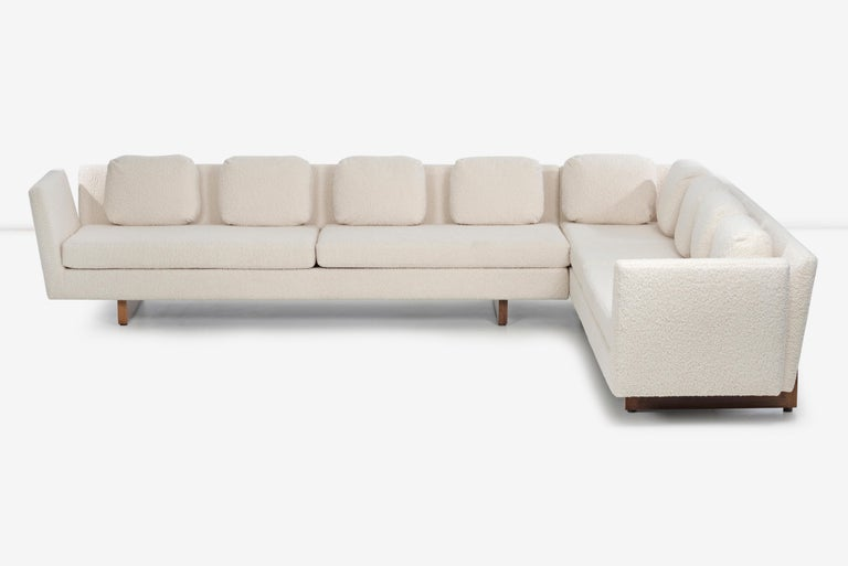 Edward Wormley for Dunbar open arm sectional sofa, completely rebuild and restored, reupholstered with Italian bouclé, pillows are down filled, also features oiled walnut bracketed supports with brass screw inserts. Good scale from and appearance