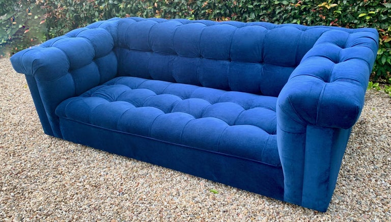 Iconic Dunbar party sofa in cerulean tufted blue velvet, designed by Edward Wormley. Large enough for a wonderful statement. However, the perfect size for bedroom, smaller reading room, or the formal living space.