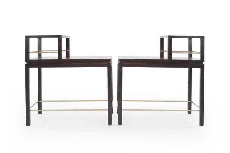 Stunningly restored set of rosewood and mahogany tiered end tables, featuring brass stretchers, designed by Edward Wormley for Dunbar, circa 1950s.