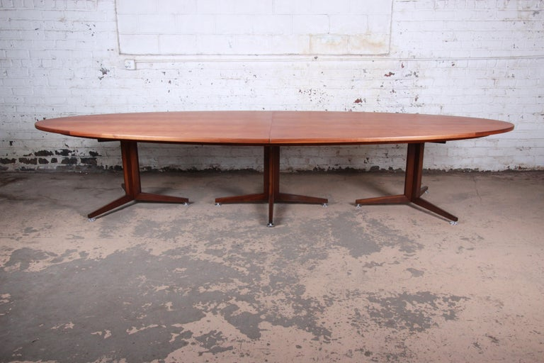 An extremely rare and exceptional Mid-Century Modern custom 14-foot walnut conference or dining table