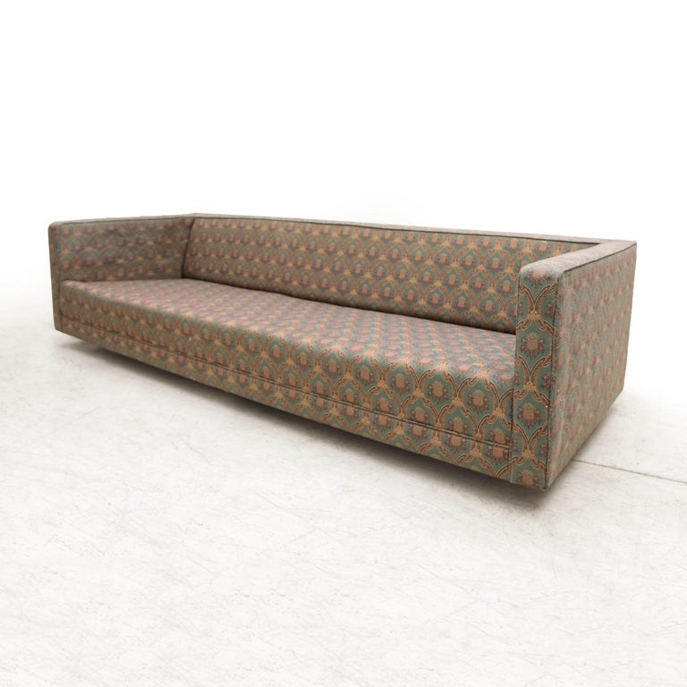 Classic four-seat sofa by Edward Wormley for Dunbar on four chrome ball wheels. This sofa needs reupholstery and it is sold as a frame and as shown in the first images, it's missing the cushions. In-house upholstery available. The last image shows