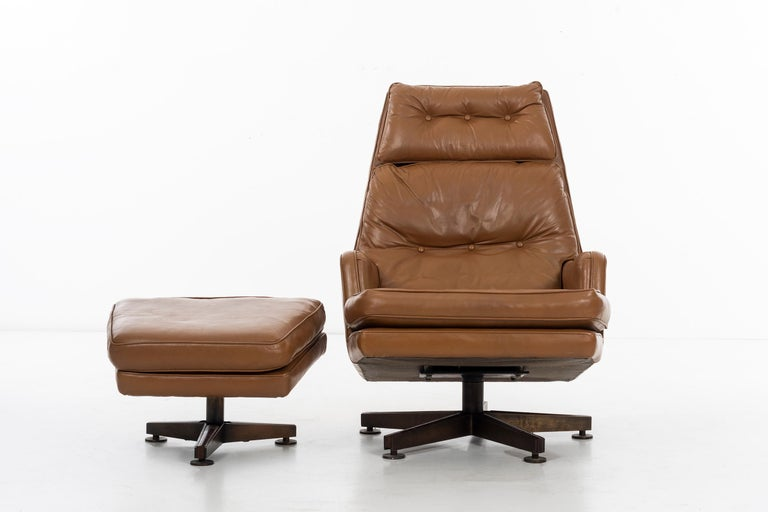Wormley for Dunbar lounge chair and ottoman. Original leather, with bronze base and inlay rosewood details. Ottoman: D: 19 W: 24 H: 16.5.