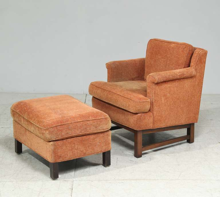 A Dunbar lounge chair with matching ottoman, designed by Edward Wormley.