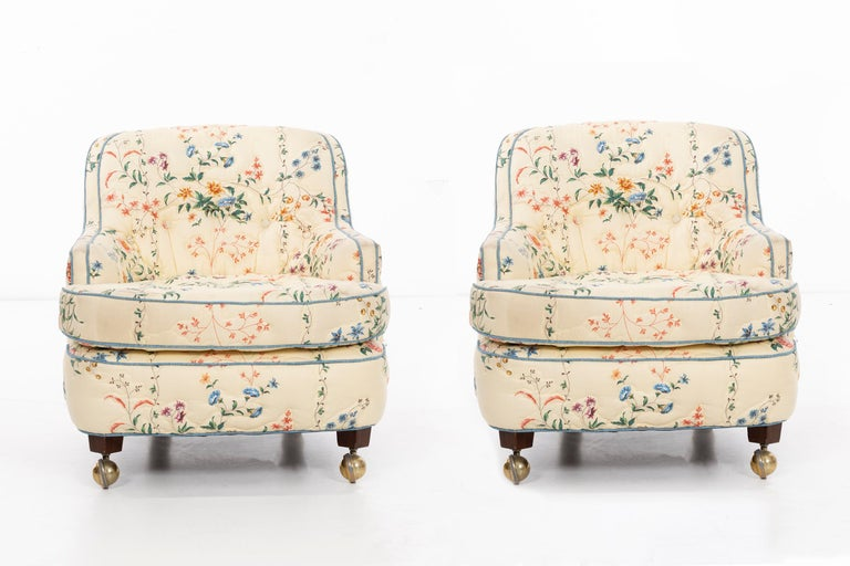 Wormley for Dunbar pair of curved-back lounge chairs with solid walnut wood tapered legs with removable wheels.