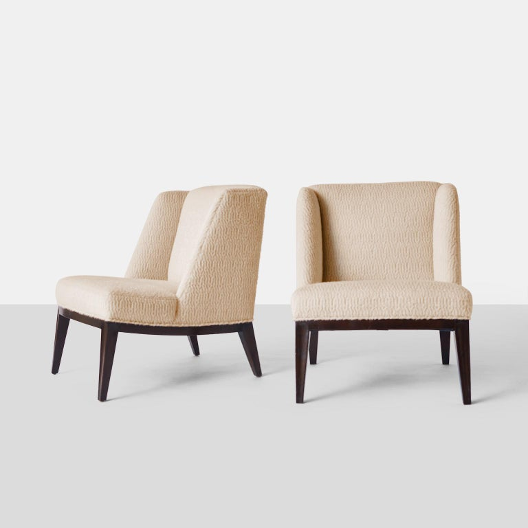 Edward Wormley lounge chairs A pair of slipper style lounge chairs with lacquered mahogany frames and restored in a luxurious Sandra Jordan Prima Suri Alpaca fabric in color French Vanilla. Each chair retains the original metal Dunbar tags. USA,