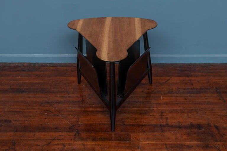Edward Wormley magazine table for Dunbar, Berne Indiana. Classic mid-century design by Edward Wormley, sophisticated yet modern. Newly refinished with original order tags intact, ready to enjoy.