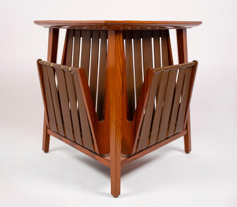 Magazine table by Edward Wormley for Dunbar, 1959. Table constructed of oak, brass and leather, very good original condition.
