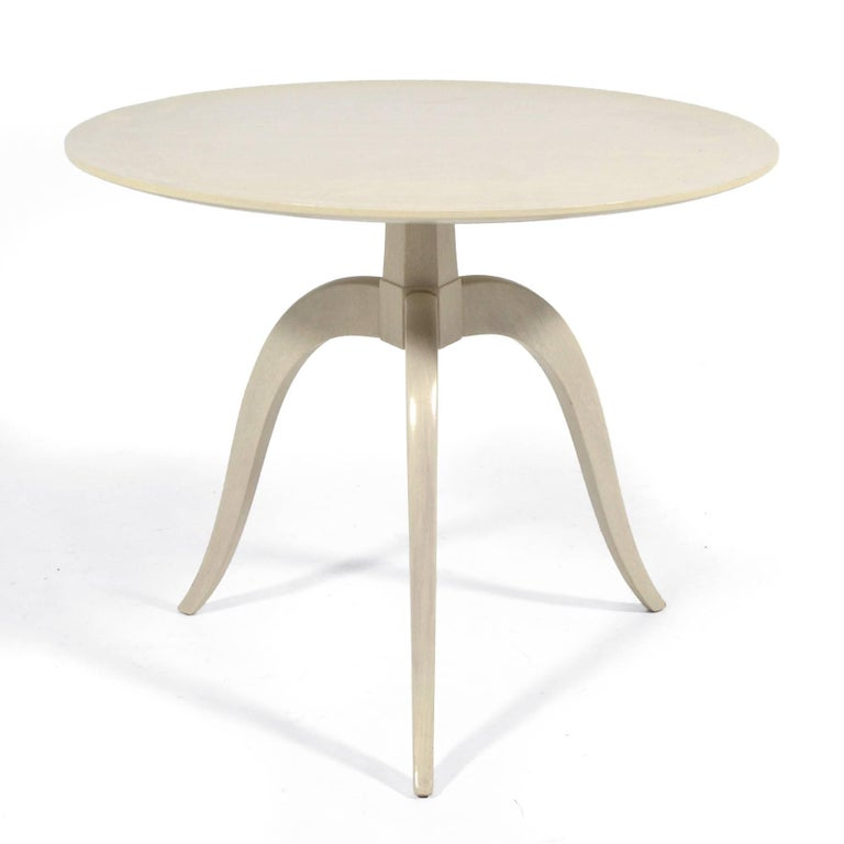 An extraordinary example of Wormley's refined sensibilities, this early design, model #2010 occasional table created in the late 1930s features a number of fine details that give the piece a delightful sculptural quality. The swag-legged base meets