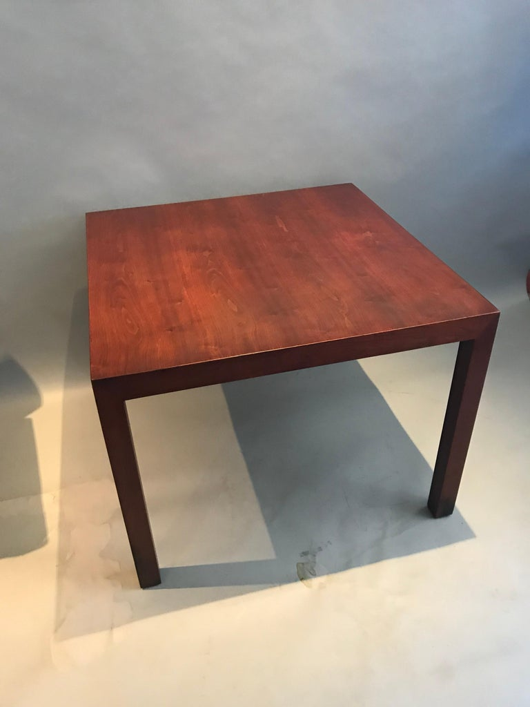 Gorgeous side or end table designed by Edward Wormley for Dunbar. A lovely walnut patina accompanies the evening and dramatic walnut grain patterns. Even color throughout with normal wear. The table is large enough to display a sculpture, plants, or