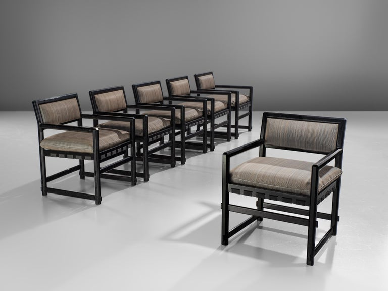 Set of six armchairs, lacquered black wood and fabric, design by Edward Wormely for Dunbar executed by Mobilier Universel, Jules Wabbes, Belgium, 1960s.