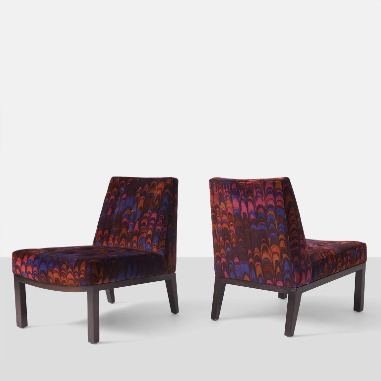 A pair of slipper chairs with tufted seat and back by Edward Wormley for Dunbar. Chairs have been upholstered in a Jack Lenor Larsen velvet and frames are mahogany.
