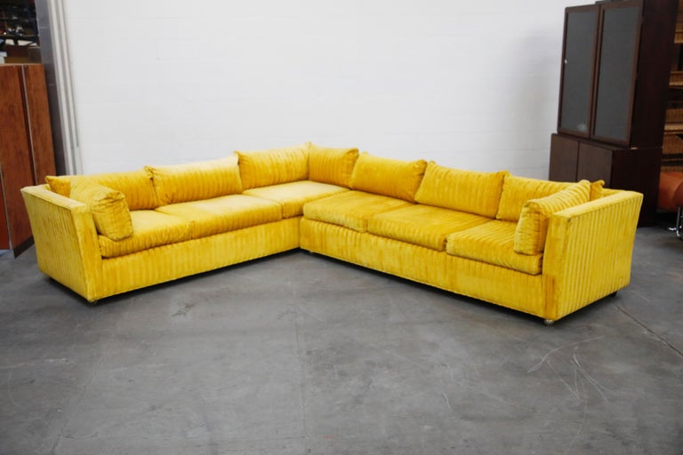 This large and incredible Edward Wormley styled two-piece sectional sofa would make an impact to any space. Upholstered in a quality Jack Lenor Larsen styled yellow and orange striped velvet fabric which is in excellent condition with no major