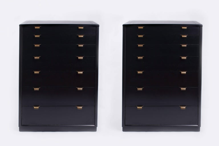 "Edward Wormley (1907–1995)  Pair of rectangular seven-drawer dressers with recessed base by Edward Wormley for Drexel, in black-lacquered wood with brass pulls.  Stamped ""Drexel"" in top drawers and on back.  United States, 1940's.   43"