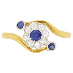 Edwardian 0.15 Carat Sapphire and Diamond Daisy Twist Ring, circa 1900s