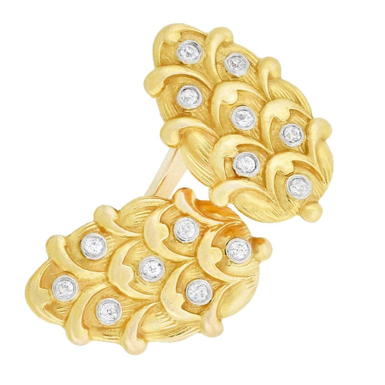 A beautiful pair of diamond cufflinks from the Edwardian (ca1910) era! Each double-sided cufflink is crafted in vibrant 14kt yellow gold with platinum accents, for a fabulous mixed metals appeal. The face of each cufflink is similar in shape to a