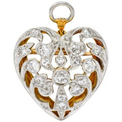 Edwardian 0.90 Carat Diamond Platinum-Topped 14 Karat Gold Heart Pendant Brooch