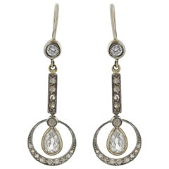 Edwardian 0.95 Total Carat Pear Cut Diamond Dangle Earrings