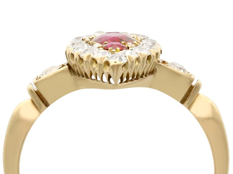 A stunning, fine and impressive antique 1.20ct Siam ruby and 1.09 carat diamond, 18 karat yellow gold and platinum set cocktail ring; part of our diverse antique jewelry and estate jewelry collections.  This stunning ruby and diamond ring has been