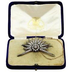 Edwardian 14 Karat Gold, Silver, and Diamond Starburst Brooch