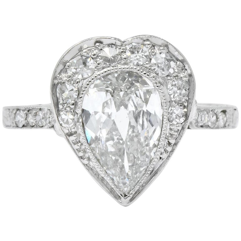 Edwardian 1.45 Carat Pear Cut Diamond Platinum Heart Engagement Ring For Sale