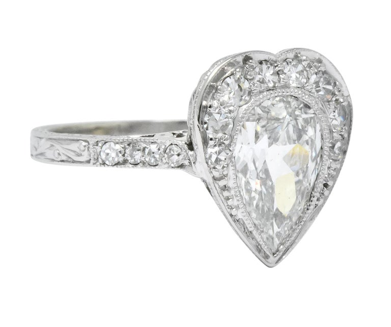 Centering a bezel set pear cut diamond weighing approximately 1.15 carats, I color and SI1 clarity  Accented with bead set single cut diamonds around and down the shank, weighing approximately 0.30 carat total, G/H color and VS to SI