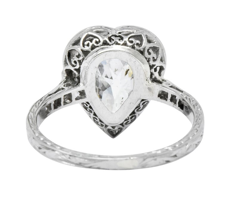 Women's or Men's Edwardian 1.45 Carat Pear Cut Diamond Platinum Heart Engagement Ring For Sale
