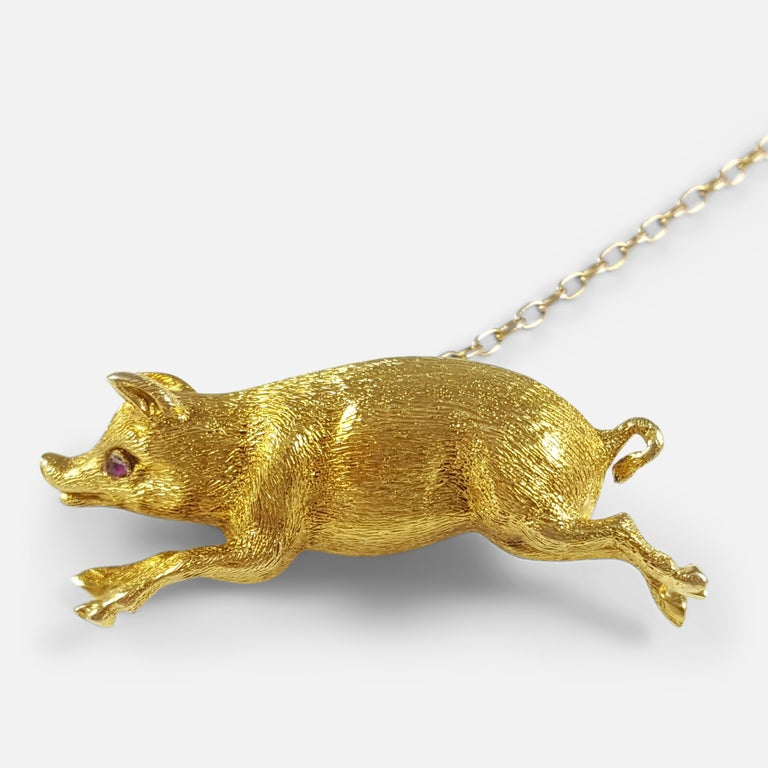 Description: - This is a beautiful, Edwardian 15 karat yellow gold pig brooch. The brooch is crafted in the form of a pig in full flight. The brooch is stamped '15ct' to the body to denote 15 karat (carat) gold. The pig has a ruby eye, which have