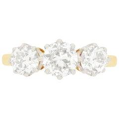 Edwardian 1.75 Carat Diamond Three-Stone Engagement Ring, circa 1910s