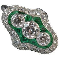 Edwardian 1.75 Carat Diamond Emerald 18 Carat White Gold Cluster Ring