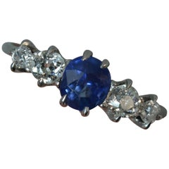 Edwardian 18 Carat White Gold Blue Sapphire Old Cut Diamond Five-Stone Ring