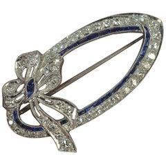 Edwardian 18 Karat White Gold Sapphire 1.00 Carat Diamond Bow Brooch