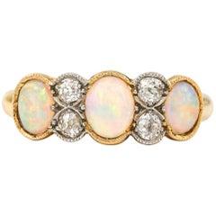 Precious Opal and Diamond 7-Stone Ring Edwardian 18k Bi-Color Gold circa 1900