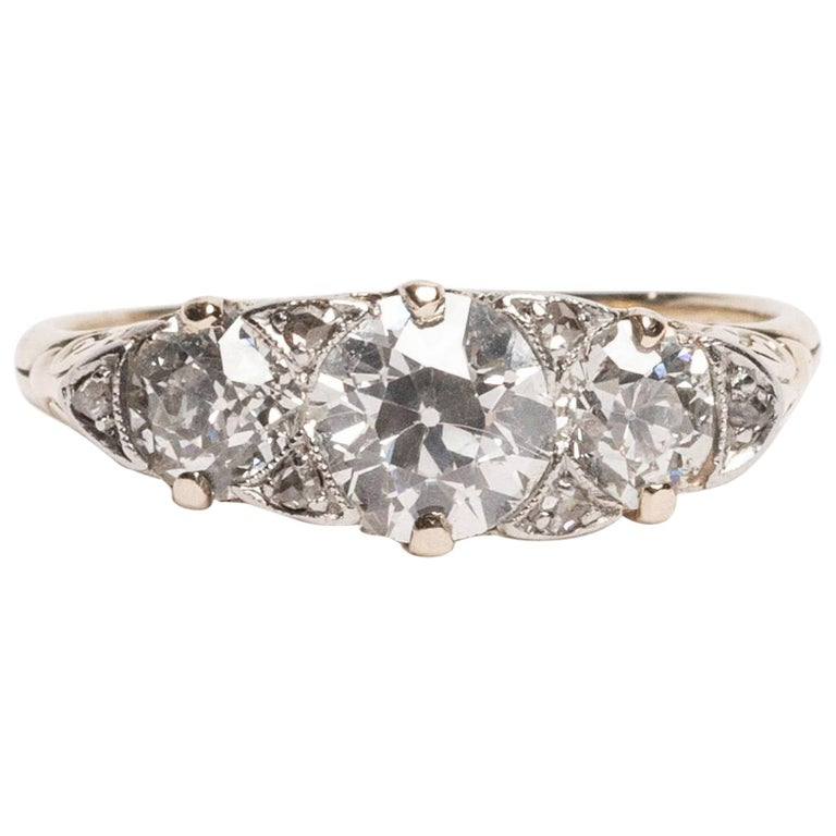 """Edwardian 2.61 Carat """"Three-Stone"""" Yellow Gold and Platinum Low Profile Ring For Sale"""