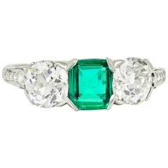 Edwardian 2.71 Carat Emerald Diamond Platinum Three-Stone Ring, circa 1915