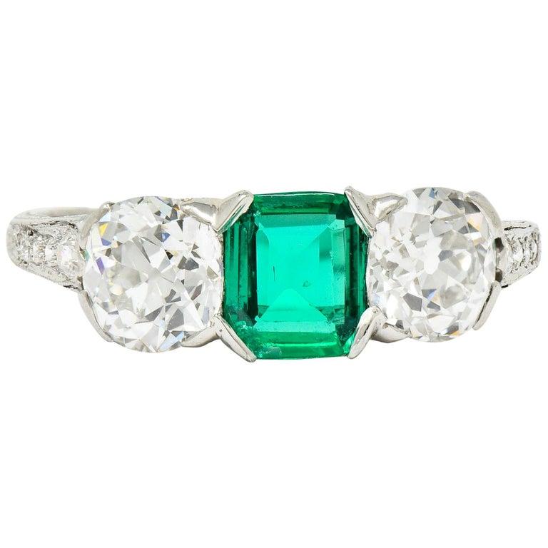 Edwardian 2.71 Carat Emerald Diamond Platinum Three-Stone Ring, circa 1915