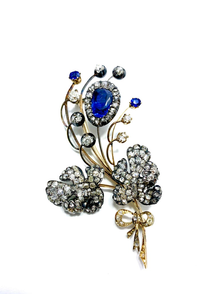 Edwardian 3.02 Carat Pear Shape Sapphire and Diamond Silver over Gold Bouquet In Excellent Condition For Sale In Washington, DC