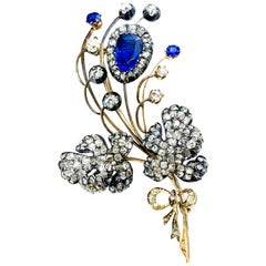Edwardian 3.02 Carat Pear Shape Sapphire and Diamond Silver over Gold Bouquet