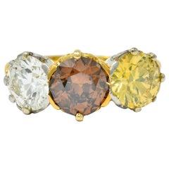 Edwardian 4.31 Carat Fancy Diamond 18 Karat Gold Platinum Three-Stone Ring