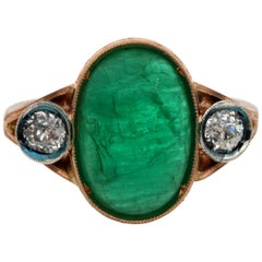Edwardian 4.50 Carat Natural Emerald .60 Carat Diamond Three-Stone Ring