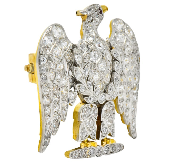 Depicting an eagle with laurel branches    Set with old European, old mine and single cut diamonds  Total diamond weight approximately 4.50 carats, GHI color and VS to SI clarity  With tiny round ruby cabochon eye  Gold beak and talon detail  Tested