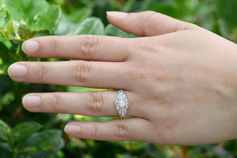 The elegance, romance and beauty of the Edwardian era shows through in this heirloom engagement ring. Meticulously crafted of platinum in a low setting and embellished with a sparkling, chunky old mine cut diamond supported by a lacy, filigree