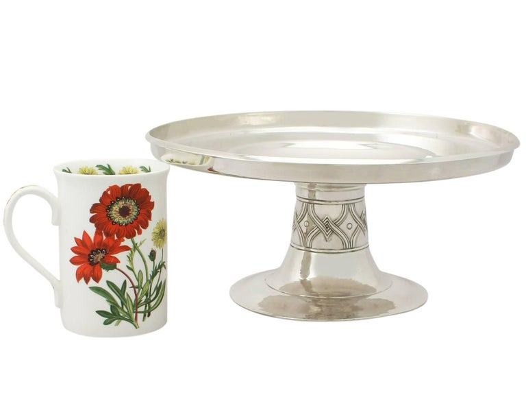 A fine and impressive antique Edwardian English sterling silver tazza in the Arts & Crafts style; part of our ornamental silverware collection  This fine antique Edwardian sterling silver tazza has a plain circular form onto a circular spreading